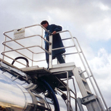 operator using a mobile tanker loading system